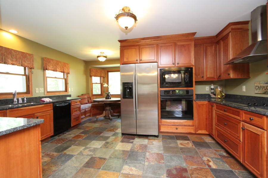 Large renovated/updated kitchen: granite, slate, cherry cabinets...