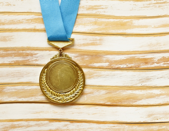 gold medal with blue ribbon