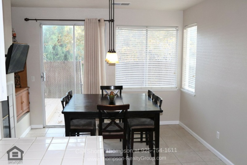 Antioch CA Homes for Sale - The cheerful dining area is the perfect spot for gatherings and celebrations.