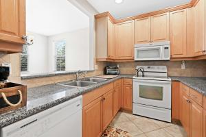 Abacoa Antigua kitchen with granite counters and wood cabinets