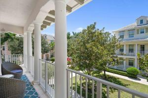Abacoa Antigua townhome with wrap around balcony for sale in Jupiter Florida