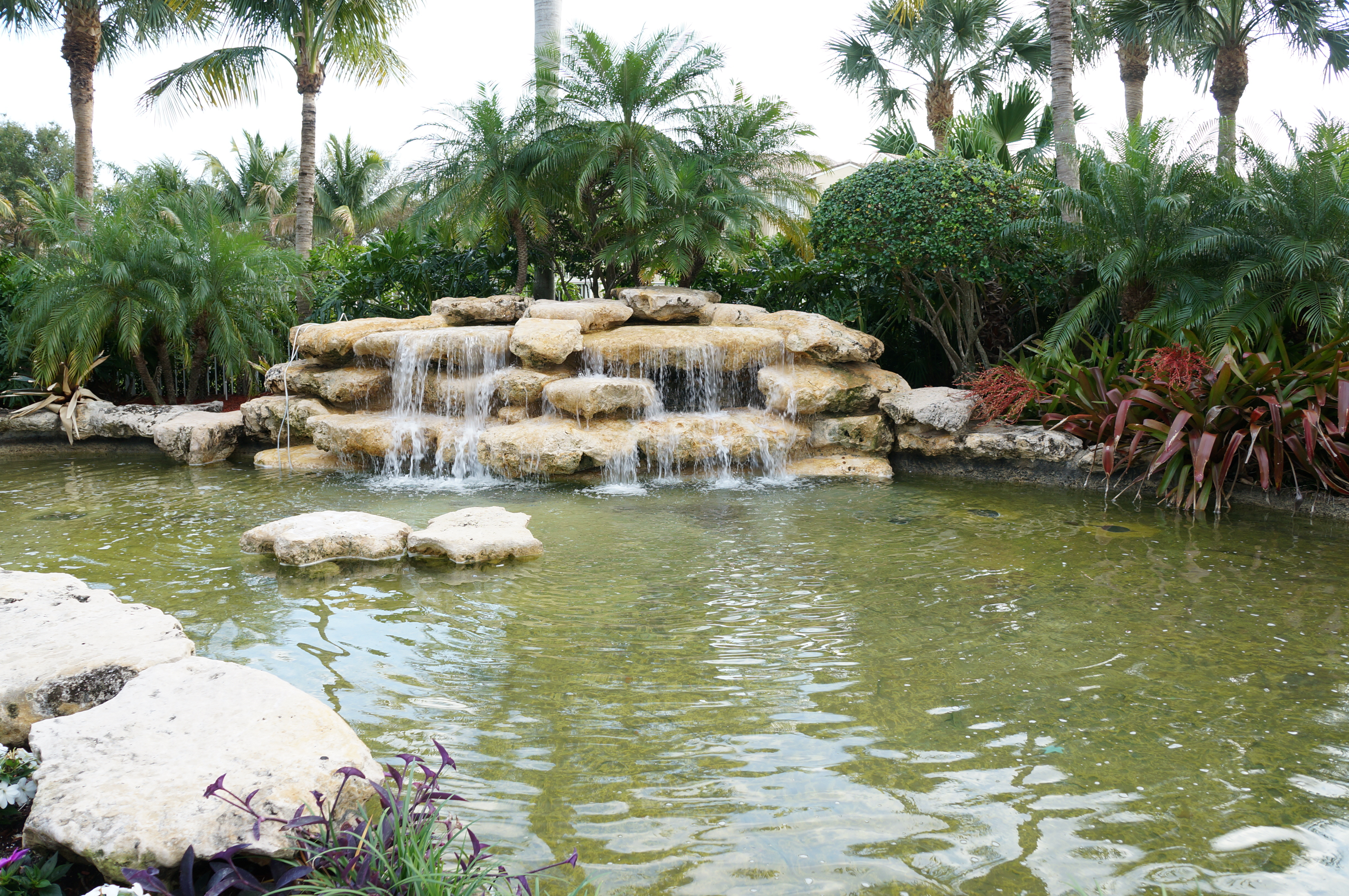 Poolside water feature at Lighthouse Cove Tequesta Condos