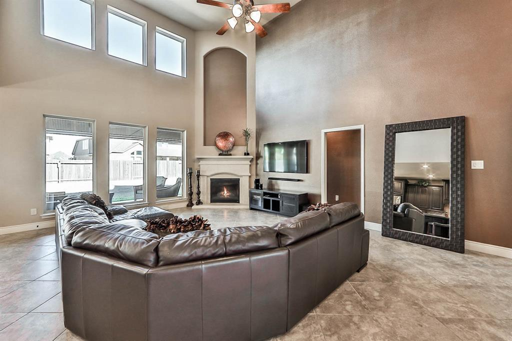Open Concept Floor Plan Features Soaring 2 Story Ceiling Gas Log Fireplace Granite Countertops Crown Molding Wrought Iron Spindles Hardwood Flooring