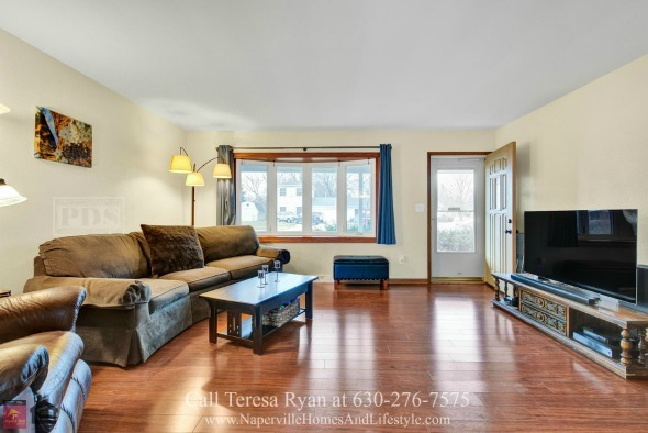 North Aurora IL Homes - Experience warmth and comfort in the bright and charming living room of this home for sale in North Aurora IL.