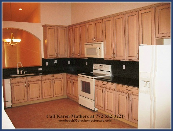 The updated kitchen in this Vero Beach FL condo for sale, with granite countertops, sturdy storage shelves, and appliances to make you want to cook sumptuous meals all day long.