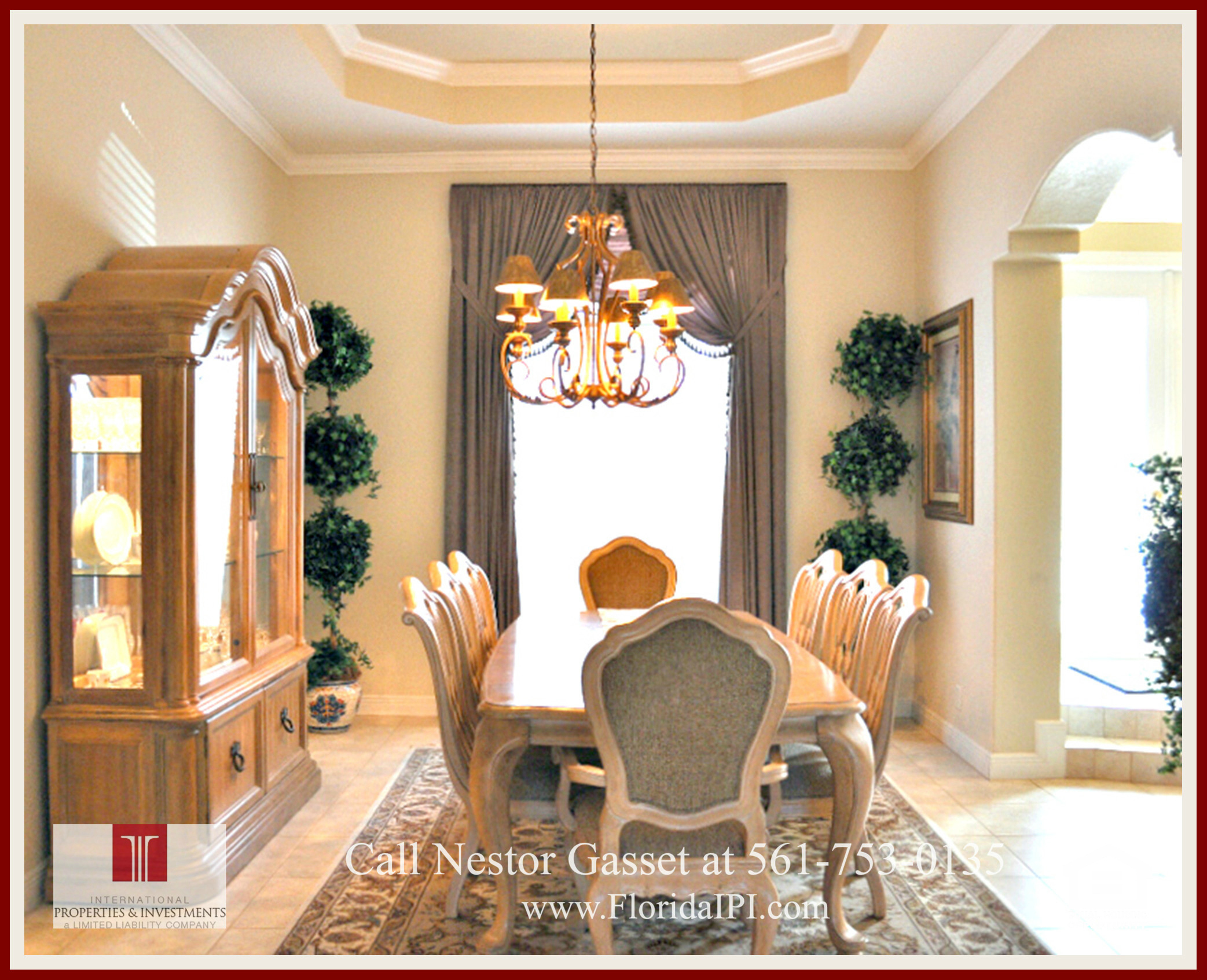West Palm Beach Fl golf course community estate home for sale - The formal dining room of this golf course community estate home for sale in West Palm Beach FL features a tray ceiling design accented with beautiful crown molding.